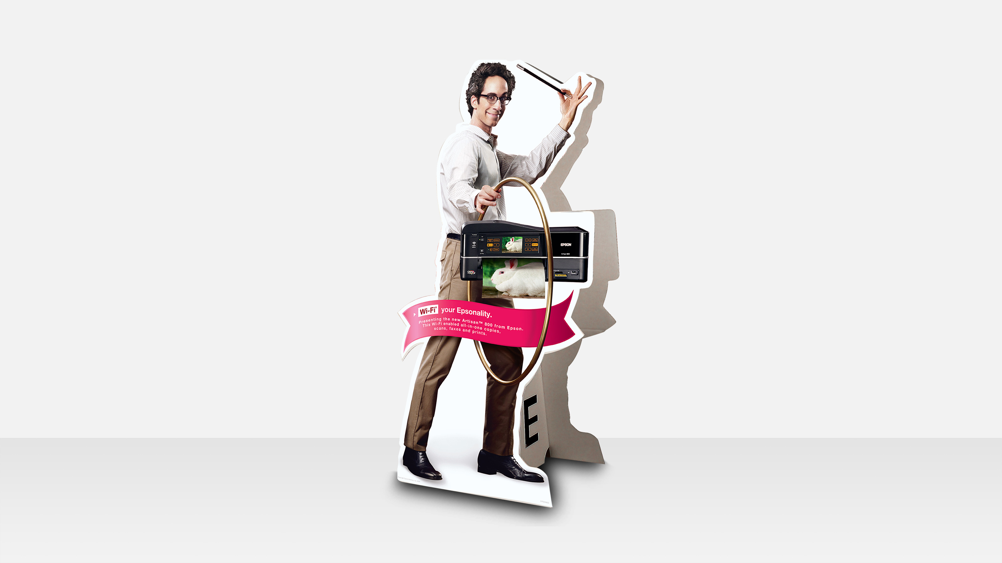 epson point of purchase marketing stand with a man and a cordless printer