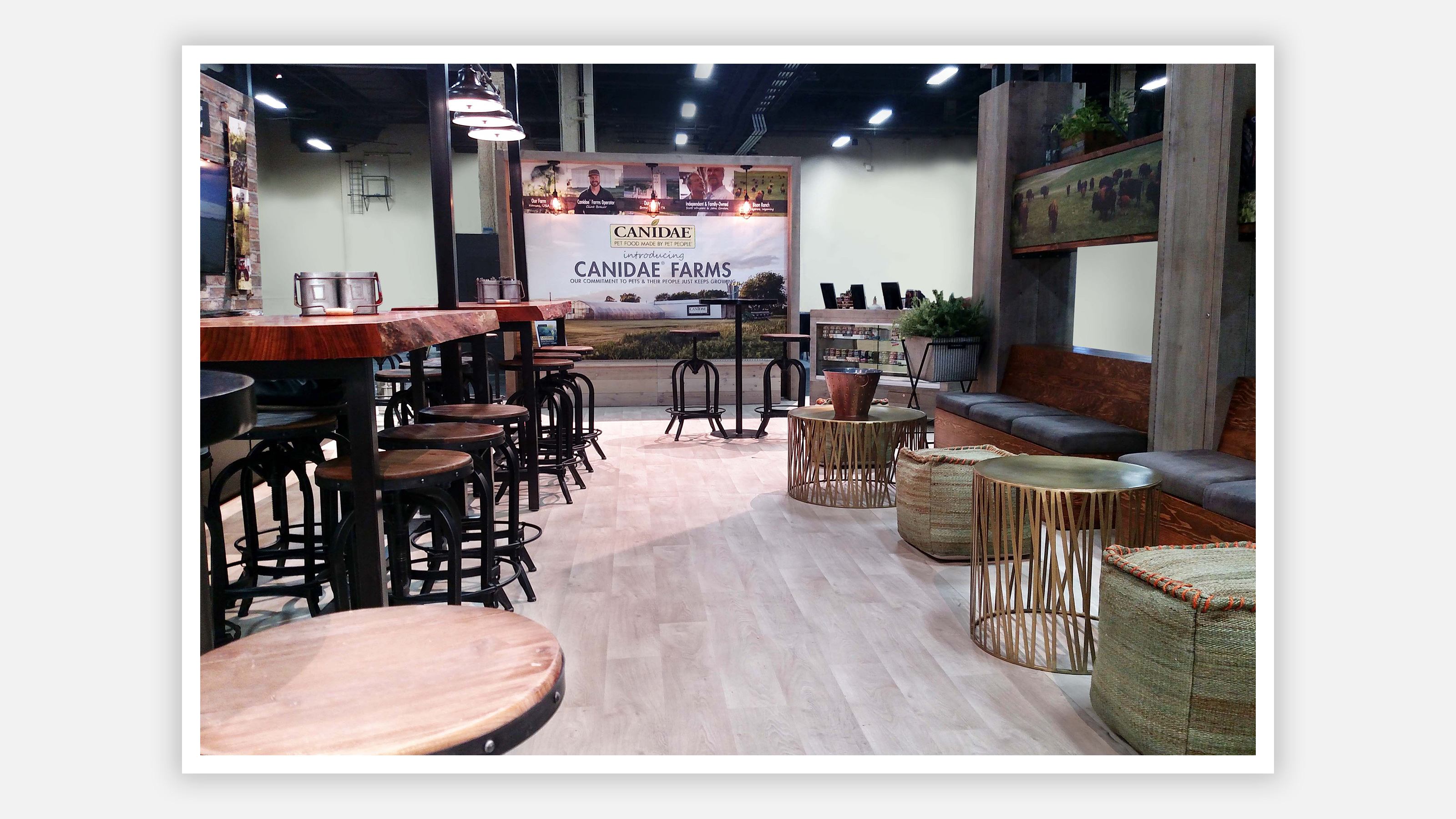 canidae tradeshow booth with tables chairs and posters